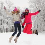 Winter girl jump Stock Images