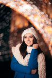 Winter Girl with Knitted Beanie and Scarf Enjoying Christmas royalty free stock images