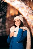 Winter Girl with Knitted Beanie and Scarf Enjoying Christmas royalty free stock photography