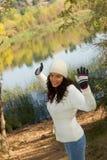 Winter girl by lake Stock Photos