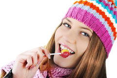 Winter Girl licking candy Stock Images