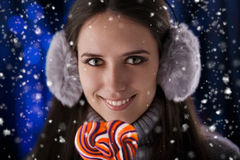 Winter Girl with Lollypop Royalty Free Stock Photos