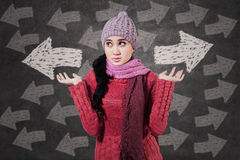 Winter girl looking at arrows Stock Photo