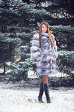 Winter Girl in Luxury Fur Coat Royalty Free Stock Photo