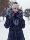 Winter Girl in Luxury Fur Coat. Fashion. Beautiful Russian girl in a chic winter coat Stock Image
