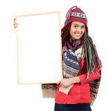 Winter girl with many plaits keeping blank board Stock Image