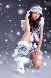 Winter girl with many snowflakes Stock Photo