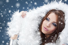 Winter girl with many snowflakes Stock Image