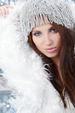 Winter girl with many snowflakes Royalty Free Stock Photos