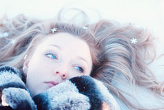Winter girl with many snowflakes Royalty Free Stock Photo