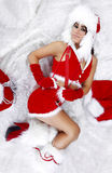 Winter girl napping on white fur Stock Images