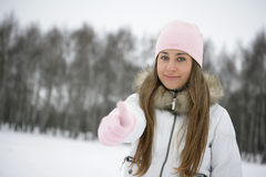 Winter girl. OK. Girl in the park in winter. Hand. Sign ok Royalty Free Stock Photos