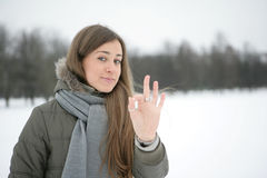 Winter girl. OK sign. Girl in the park in winter. Hand. Sign ok Royalty Free Stock Images