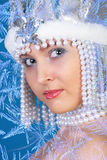 Winter girl over blue Royalty Free Stock Photos