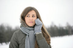 Winter girl on the phone. Girl in the park in winter on the phone and smiling Stock Images
