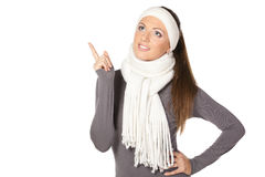 Winter girl pointing up Royalty Free Stock Images