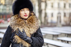 Winter girl posing in park Royalty Free Stock Photography