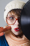 Winter girl with record Royalty Free Stock Images