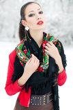Winter girl in red cardigan with russian kerchief Royalty Free Stock Image