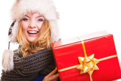 Winter girl with red gift box isolated Stock Images