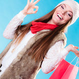 Winter girl with red paper shopping bag Stock Images