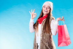 Winter girl with red paper shopping bag Royalty Free Stock Image