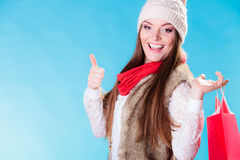 Winter girl with red paper shopping bag Royalty Free Stock Photos