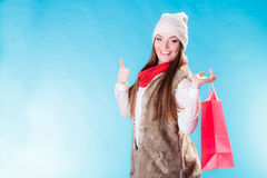 Winter girl with red paper shopping bag Stock Photos