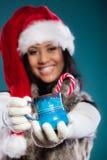 Winter girl santa helper hat holds blue mug Royalty Free Stock Photography