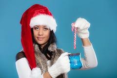 Winter girl santa helper hat holds blue mug Royalty Free Stock Photos
