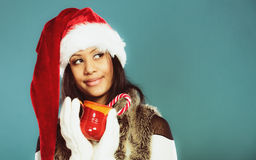 Winter girl santa helper hat holds red mug Stock Photography