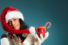 Winter girl santa helper hat holds red mug Stock Images