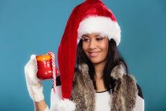Winter girl santa helper hat holds red mug Stock Photography