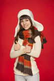 Winter girl showing thumbs up Royalty Free Stock Image
