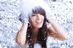 Winter girl on silver background Royalty Free Stock Photo