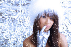Winter girl on silver background Royalty Free Stock Images