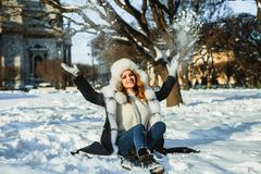 Winter girl with snow outdoor. Happy woman portrait stock photography