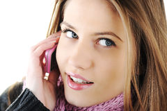 Winter Girl speaking on cell phone Royalty Free Stock Images