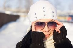 Winter Girl in a sunglasses Stock Photography