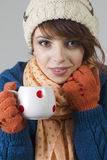 Winter girl with tea Stock Images