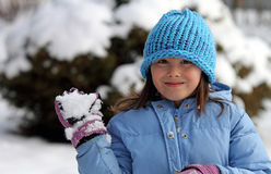 Winter Girl Throwing Snow Stock Photos