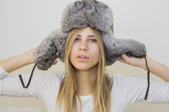 Winter girl wearing grey fur hat Stock Image
