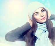 Winter girl wearing hat and scarf. Beauty winter girl wearing hat and scarf Stock Photos