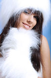 Winter girl wearing white fur royalty free stock photography