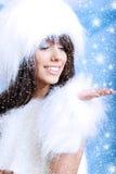 Winter girl wearing white fur Stock Images