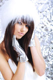Winter girl wearing white fur Royalty Free Stock Image