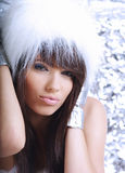 Winter girl wearing white fur Royalty Free Stock Photo