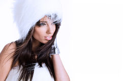 Winter girl wearing white fur Stock Photos