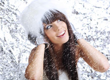 Winter girl wearing white fur hat Stock Photography