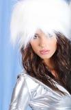 Winter girl wearing white fur hat Stock Photos